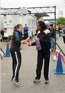 I simply do not get tired of this photo of Jackie Joyner Kersee  handing me a medal at Bridge The Gap.
