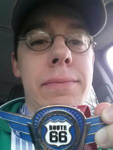 Doug snapped this picture with his super-cool half marathon finisher's medal right before he drove home!