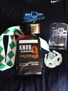 My race goodies! Yeah, I splurged for the bottle of bourbon.