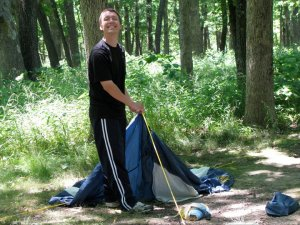Justin putting up a tent at Sand Ridge State Forest